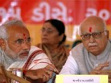 Narendra Modi (R) and LK Advani (L). PHOTO: REUTERS