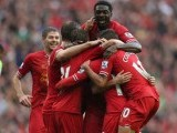 Liverpool players huddle up for an embrace after scoring a goal. PHOTO: REUTERS