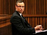 Oscar Pistorius sitting in his dock during the trial. PHOTO:AFP