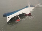 South Korean ferry is seen sinking in the sea off Jindo April 16, 2014, in this picture provided by Korea Coast Guard and released by Yonhap. PHOTO: REUTERS/KOREA COAST GUARD/YONHAP