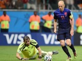 Robben sealed a 5-1 success with another marvellous individual goal, showcasing dazzling pace to escape the Spanish defending line, rounding Casillas and blitzing the ball into net. PHOTO: AFP