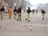 An Express News screengrab of police trying to disperse the protesters.