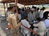 Registration of IDPs coming out of Mirali takes place at the Khajori check post. PHOTO: ISPR
