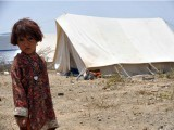 An internally displaced Pakistani girl, fleeing a military operation against Taliban militants in the North Waziristan tribal agency, looks on at a makeshift refugee camp in Bannu on June 28, 2014. PHOTO: AFP