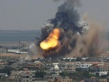 An explosion in Rafah in the southern Gaza Strip, after what police said was an Israeli airstrike. PHOTO: REUTERS