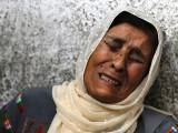 The mother of Palestinian Mohammed Attallah mourns his death at a hospital in the West Bank city of Ramallah. PHOTO: REUTERS