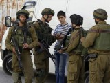Israeli soldiers search a Palestinian youth during an operation to locate three Israeli teens in the West Bank city of Hebron June 16, 2014. PHOTO: REUTERS