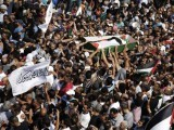 Palestinians carry the body of 16-year-old during his funeral in Shuafat, an Arab suburb of Jerusalem July 4, 2014. PHOTO: REUTERS