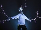 Member of Thunderbolt Craziness band wearing a metal suit balances a soccer ball on his head as electricity is discharged from Tesla coils during a performance to celebrate 2014 Brazil World Cup. PHOTO: REUTERS