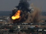 Smoke and flames follow an Israeli airstrike in the Gaza Strip on July 8, 2014. PHOTO: REUTERS
