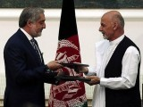 Abdullah Abdullah, left, and Ashraf Ghani signed the agreement in the presidential palace in Kabul. PHOTO: REUTERS