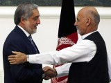 Afghan rival presidential candidates Abdullah Abdullah (left) and Ashraf Ghani shake hands after exchanging signed agreements for the country's unity government in Kabul September 21, 2014. PHOTO: REUTERS