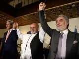 (From L) US Secretary of State John Kerry, Afghan presidential candidates Ashraf Ghani and Abdullah Abdullah hold hands during a joint press conference in Kabul. PHOTO: AFP