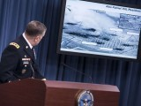 U.S. Army Joint Staff Director of Operations Lt. Gen. William Mayville Jr. shows before and after images of airstrikes in Syria during a briefing at the Pentagon. U.S. and Arab nations staged joint airstrikes overnight against Islamic State targets in Syria and unilateral airstrikes against an al-Qaeda group in Syria. PHOTO: AFP