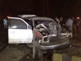 Vehicle of SSP Farooq Awan destroyed in bomb attack on Thursday evening. PHOTO: TOOBA MASOOD/EXPRESS