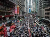 Demonstrators march during a pro-democracy rally seeking greater democracy in Hong Kong as frustration grows over the influence of Beijing on the city. PHOTO: AFP