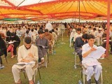 Students take the medical and dental colleges' entrance tests under sprawling tents at Grassy Ground, Saidu Sharif. PHOTO: EXPRESS FILE