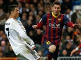 Barcelona's Lionel Messi (R) and Real Madrid's Cristiano Ronaldo challenge for the ball during La Liga's second 'Clasico' soccer match of the season at Santiago Bernabeu stadium in Madrid March 23, 2014. PHOTO: REUTERS