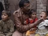 Shama's father with her three children. PHOTO: EXPRESS TRIBUNE