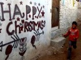 Minority Pakistani Christians walk on an alley past Christmas decorations in Islamabad. PHOTO : AFP