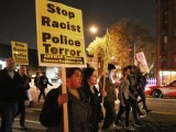Hundreds of demonstrators march down the middle of U Street Northwest after a grand jury did not indict the white police officer who killed an unarmed black teenager in Missouri November 24, 2014. PHOTO: AFP