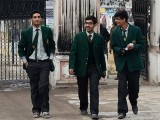 Students leaving school after first day of APS reopening. PHOTO: AFP