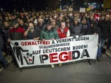 A picture taken on December 15, 2014 shows supporters of the PEGIDA movement, taking part in a rally in Dresden, eastern Germany. PHOTO: AFP