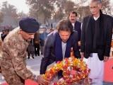 PTI chief Imran Khan lays a wreath while visiting Peshawar. PHOTO: PTI TWITTER