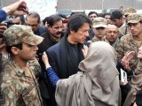 PTI chief Imran Khan speaking with parents of the Army Public School during his visit to Peshawar. PHOTO: INP