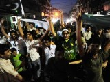Cricket fans celebrating on a street in Karachi on March 23, 2011, after Pakistan won their quarter-final Cricket World Cup tournament match against the West Indies. PHOTO: AFP