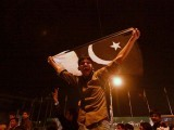A cricket fan in Lahore waves the Pakistani flag. PHOTO: REUTERS