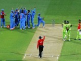 Members of India's cricket team celebrate after an electronic review confirmed the dismissal of Pakistan's batsman Umar Akmal (3rd R), caught by wicket keeper Mahendra Dhoni, during their Cricket World Cup match in Adelaide, February 15, 2015. PHOTO: REUTERS