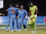 Indian players hug Mohammad Shami after the dismissal of Pakistan's batsman Wahab Riaz (R), caught by wicket keeper Mahendra Dhoni (2nd R) during their Cricket World Cup match in Adelaide, February 15, 2015. PHOTO: REUTERS