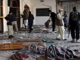 Security personnel inspect a mosque inside Imamia Imambargah after an attack by Taliban militants in Peshawar on February 13, 2015. PHOTO: AFP