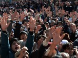 Shia Muslims shout slogans during a protest against the killing of Shia community members in a bombing in Quetta on January 23, 2014. PHOTO: AFP