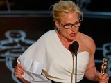 Patricia Arquette accepts her Best Supporting Actress Oscar. Photo: Reuters