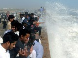 Heavy rains and strong winds continued to lash the southwestern coast of Pakistan early Sunday as Cyclone Phet approached landfall.  PHOTO: AFP