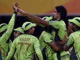 Mohammad Irfan is mobbed by team-mates after he dismissed Chamu Chibhabha, Pakistan v Zimbabwe, World Cup 2015, Group B, Brisbane, March 1, 2015. PHOTO: AFP