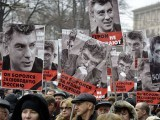Russia's opposition supporters carry portraits of Boris Nemtsov during the march. PHOTO: AFP