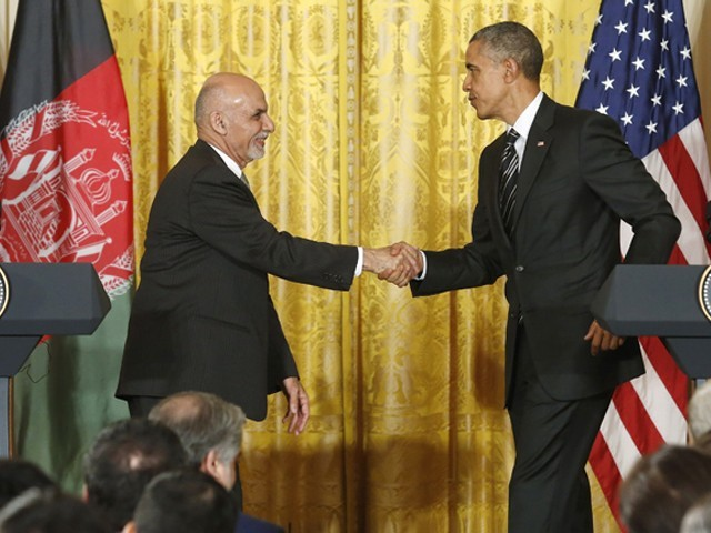 Afghanistan's President Ashraf Ghani (L) shakes hands with U.S. President Barack Obama after their joint news conference at the White House in Washington March 24, 2015. PHOTO: REUTERS