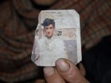 This photograph taken on March 12, 2015 shows one of the Azad Kashmir parents of convicted killer Shafqat Hussain holding a photograph of their son in Muzaffarabad, the capital of Pakistani-administered Kashmir. PHOTO: AFP