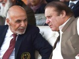 Ashraf Ghani and Nawaz Sharif watch cricket together in Islamabad, November 2014. PHOTO: AFP