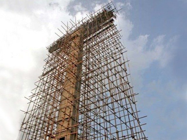 The Henry Gill family is financing the construction of a 140-foot-tall cross in one of the cities oldest Christian cemeteries. PHOTO: ATHAR KHAN/EXPRESS