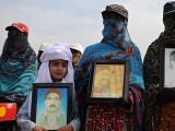 Some of the Balochistan marchers with pictures of their missing and disappeared relatives. This picture was taken in the town of Dina, 100km south of Islamabad. PHOTO: AFP