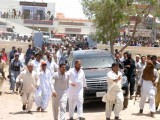 Mirza along with his supporters arriving at the Model Police Station in Badin. PHOTO: ONLINE