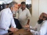 This TV grab shows former Sindh minister Zulfiqar Mirza shouting at a police official in Badin. PHOTO: EXPRESS