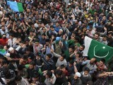 Kashmiris shout anti-India and pro-freedom slogans as Kashmiri leader Syed Ali Shah. PHOTO: AFP