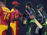 Shahid Afridi and teammate Sarfraz Ahmed shake hands with Zimbabwean captain Elton Chigumbura at the end of the first T20 International at the Gaddafi Cricket Stadium in Lahore. PHOTO: AFP