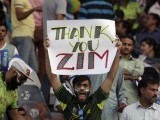 A Pakistani cricket fan holds up a placard during the Twenty20 Cricket match between Pakistan and Zimbabwe in Lahore, Pakistan, May 22, 2015. PHOTO: REUTERS