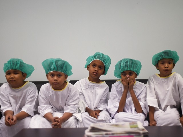 Malaysian boys wait their turn during a mass-circumcision ceremony at the Tuanku Mizan Army hospital in Kuala Lumpur. PHOTO: AFP